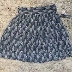 💋 3/$30 NWT black/tan Starburst mini skirt
